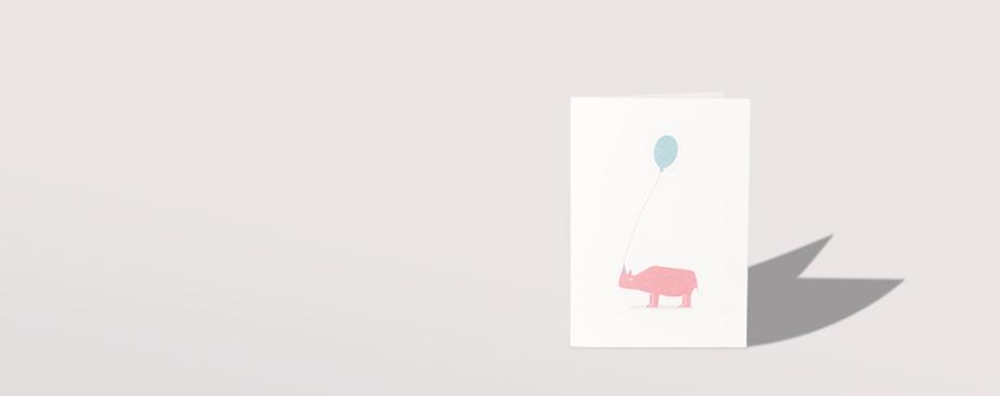 Grusskarte pinkes Nashorn mit Ballon